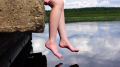 Relaxed legs over lake water - stock footage