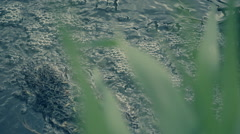 The streams of water over the dam on the creek created the bubbles. Slow mo Stock Footage