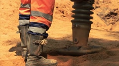 Vibratory rammer in action on a construction site Stock Footage