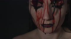 4k shoot of a horror Halloween model - Blood pouring on a Vampire face Stock Footage