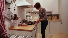 Woman Cooking Chiken Eggs in the Kitchen Stock Footage