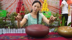 Chinese young woman performing beat ancient musical instruments Stock Footage
