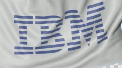 Close up of waving flag with IBM logo, seamless loop, blue background. Editorial - stock footage