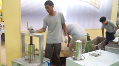 Workers processing tea drinks in the exhibition scene Stock Footage
