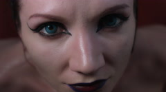 4k shoot of a horror Halloween model - Vampire eye close-up Stock Footage