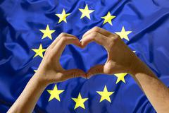 Hands heart symbol, European Union flag Stock Photos