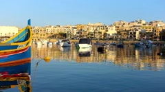 Fisherman boats in Marsaskala bay in South Malta early in the evening Stock Footage