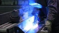 Worker with protective mask welding metal Stock Footage
