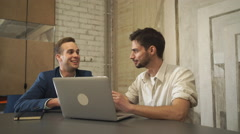 Business meeting two young partners Stock Footage