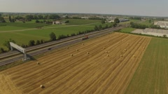 Aerial shot of fields and motorway in Europe Stock Footage