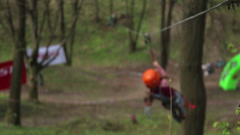 KIEV, UKRAINE - APRIL 21, 2016: Tourist crossing the ravine Stock Footage
