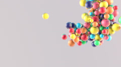 Falling of small glossy colorful 3d balls with cluster effect - stock footage