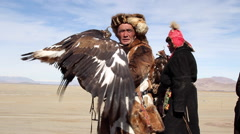 GOLDEN EAGLE HUNTER FESTIVAL FUR HAT COAT PORTRAIT Stock Footage