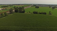 Camera flies over fields and focuses on a European highway Stock Footage