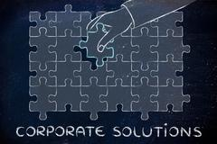 Corporate solutions, hand about to add the missing piece to a jigsaw puzzle Stock Illustration
