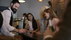 4K Bartender pouring shots for group of friends & taking photo with camera phone Stock Footage