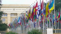 United Nations Office at Geneva in Switzerland, alley of member countries flags Stock Footage