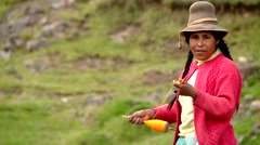 Woman spinning wool in Andes of Peru Stock Footage