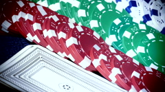 Deck of cards, dice, and poker chips - pan closeup shot. - stock footage