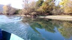 River waves on Matica river, autumn, blue sky, boat ride Stock Footage