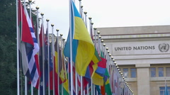 National flags of UN member countries flapping in front of Palace of Nations Stock Footage