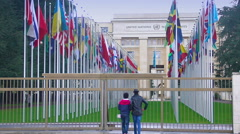 People viewing national flags alley near main UN Office in Geneva, Switzerland Stock Footage