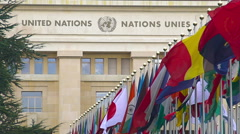 Flags in front of United Nations Organization main office in Geneva, Switzerland Stock Footage