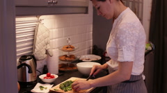 Woman Cuts Tomato and Cucumber Salad Stock Footage