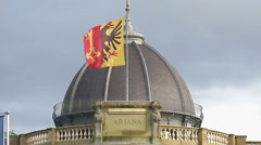 Flag with Geneva coat of arms flapping on top of Swiss Ariana artwork museum Stock Footage