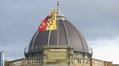 Geneva flag on Musee Ariana roof, Swiss Museum of Ceramics and Glass, slow-mo Stock Footage