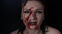 4k shoot of a horror Halloween model - Blood splash on a Vampire face Stock Footage