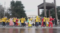 Young Asian people performing dance, Broken Chair in Geneva, peaceful assembly Stock Footage