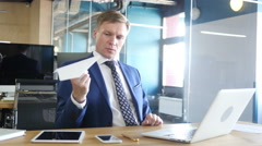 Businessman Holding Paper Plane, Thinking an Idea Stock Footage