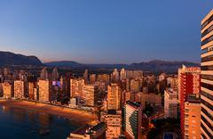 Aerial view of a Benidorm city coastline at sunset. Spain - stock photo