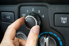 Turning on car air conditioning system - stock photo