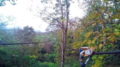 POV of a zip line ride. Group of young people waiting on a tree. - stock footage