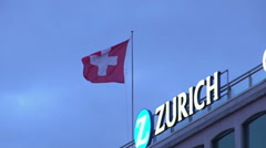 Swiss national flag flapping on top of building in Zurich, travel to Switzerland Stock Footage
