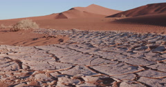 4K close-up moving shot of dried cracked mud inside the Namib-Naukluft National Stock Footage