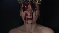 4k shoot of a horror Halloween model - Vampire with blood pouring on her head Stock Footage