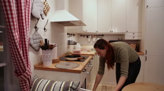 Woman Gathers in the Kitchen Food Processor Stock Footage