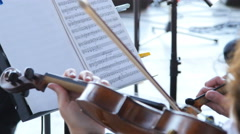 Playing the violin in the orchestra Stock Footage