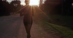 4K fit healthy woman jogging in suburbia - stock footage