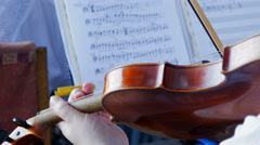playing the violin in the orchestra - stock footage