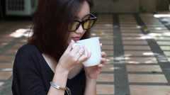 Portrait of thai adult glasses beautiful girl drinking coffee Stock Footage