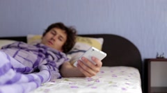 Man in Bed Wakes Up from a Phone Stock Footage