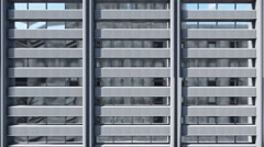 Lifting along abstract high rise office building 4K Stock Footage