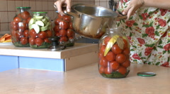 Housewife makes harvesting vegetables canned for the winter in the kitchen Stock Footage