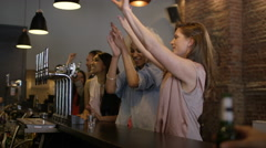 4K Bartender pouring shots for group of friends partying in city bar - stock footage