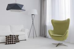 Designer egg chair adding life to subtle interior decor Stock Photos