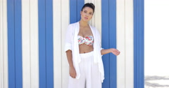 Pretty woman in white robe near wall Stock Footage